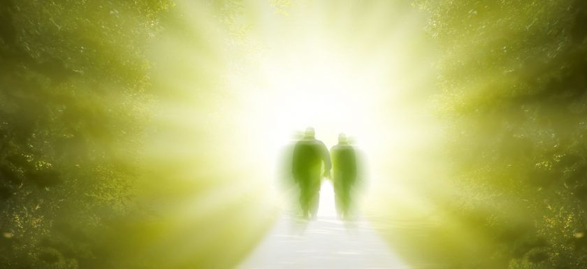 Picture of two people walking into the light of the afterlife